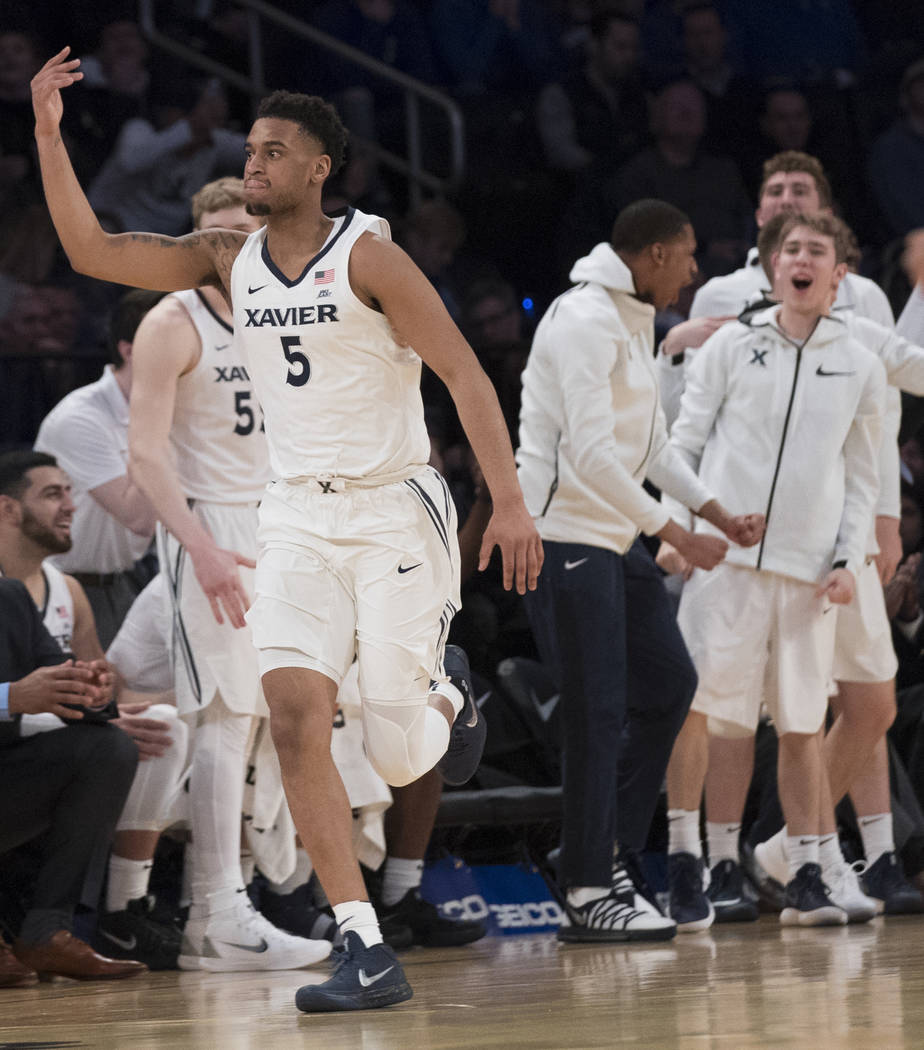 Xavier guard Trevon Bluiett gestures after scoring a basketbal during the second half of an NCAA college basketball game against St. John's in the quarterfinals of the Big East conference tourname ...