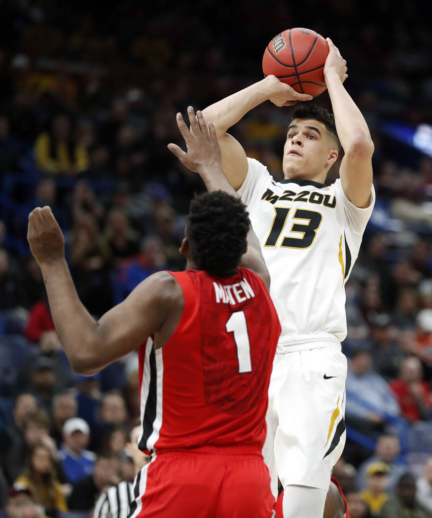 Missouri's Michael Porter Jr. (13) shoots over Georgia's Yante Maten during the first half in an NCAA college basketball game at the Southeastern Conference tournament Thursday, March 8, 2018, in  ...