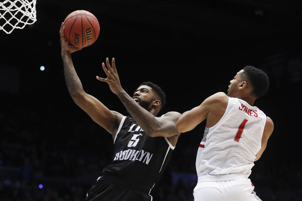 LIU Brooklyn's Zach Coleman (5) shoots against Radford's Carlik Jones (1) during the first half of a First Four game of the NCAA men's college basketball tournament, Tuesday, March 13, 2018, in Da ...