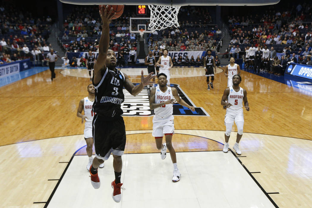 LIU Brooklyn's Jashaun Agosto (3) lays up a shot during the first half of a First Four game of the NCAA men's college basketball tournament against Radford, Tuesday, March 13, 2018, in Dayton, Ohi ...
