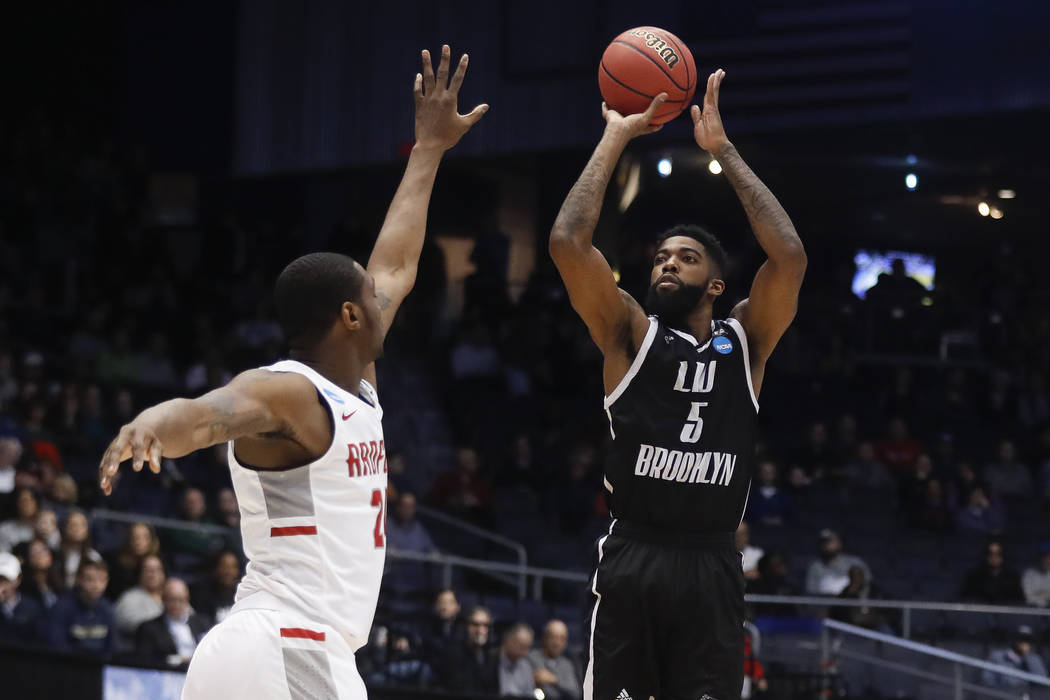 LIU Brooklyn's Zach Coleman (5) shoots against Radford's Ed Polite Jr. during the first half of a First Four game of the NCAA men's college basketball tournament, Tuesday, March 13, 2018, in Dayto ...