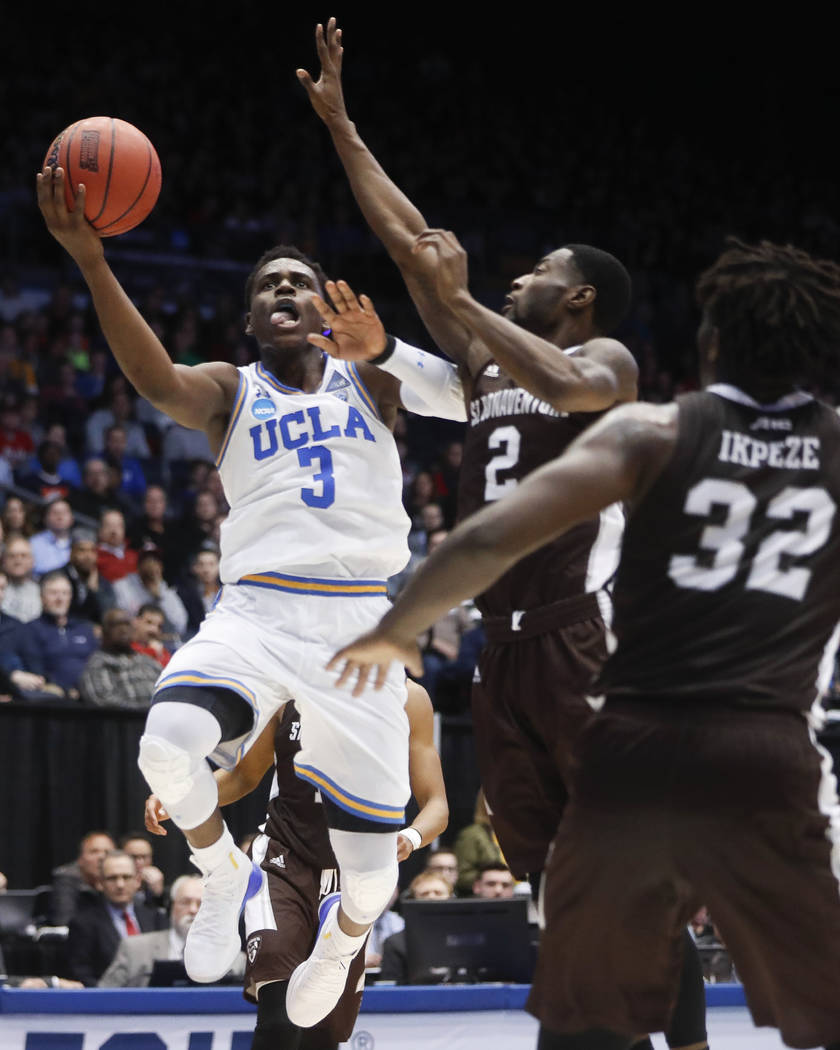 UCLA's Aaron Holiday (3) shoots against St. Bonaventure's Matt Mobley (2) during the first half of a First Four game of the NCAA men's college basketball tournament, Tuesday, March 13, 2018, in Da ...