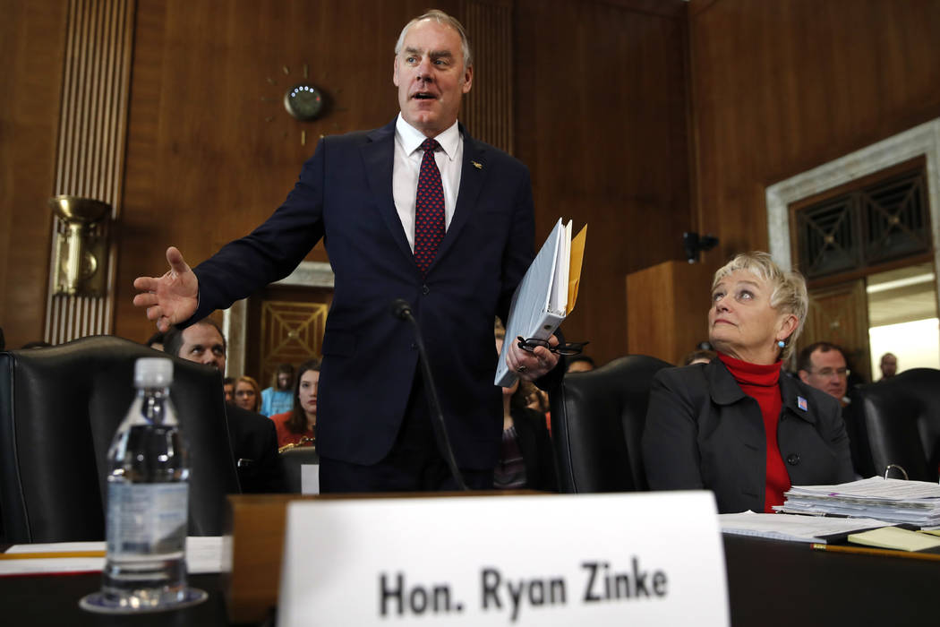 Interior Secretary Ryan Zinke arrives to testify before the Senate Committee on Energy and Natural Resources at a committee hearing on the President's Budget Request for Fiscal Year 2019, Tuesday, ...