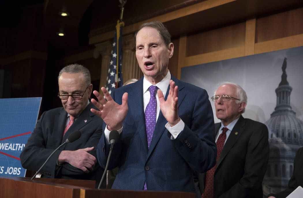 Senate Finance ranking member Ron Wyden, D-Ore., center, flanked by Senate Minority Leader Chuck Schumer, D-N.Y., left, and Senate Budget Committee Ranking Member Bernie Sanders, I-Vt., speaks to  ...