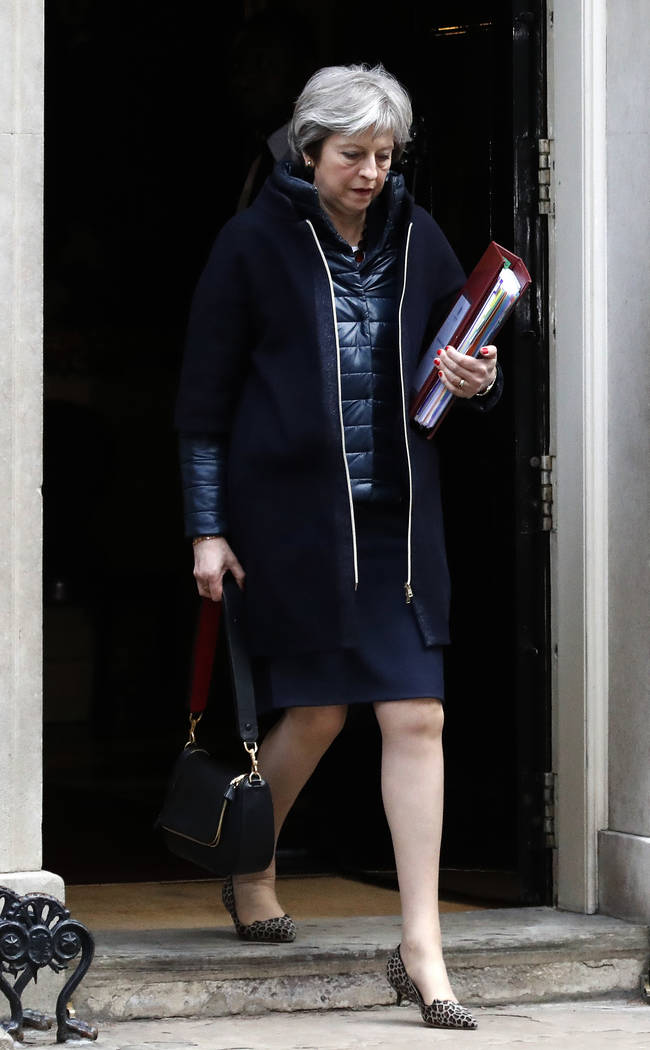 Britain's Prime Minister Theresa May leaves 10 Downing Street to attend the weekly Prime Minister's Questions session, in Parliament in London, Wednesday, March 14, 2018. (Frank Augstein/AP)