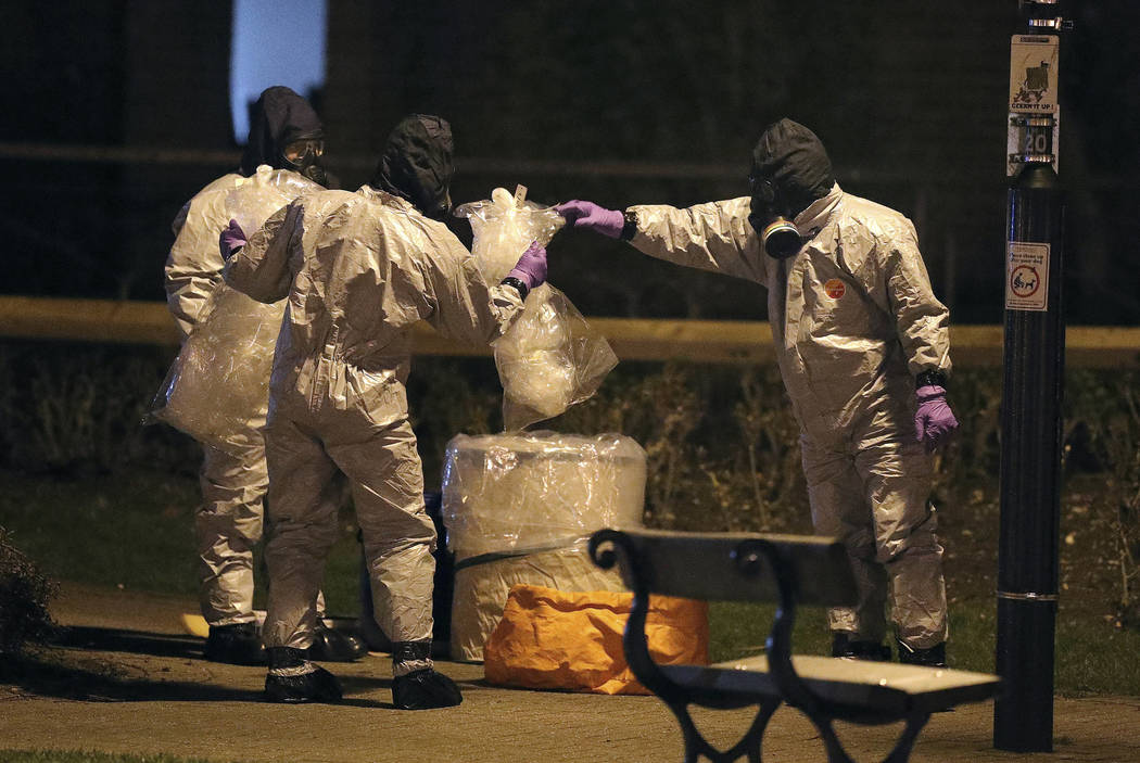 Investigators in protective suits work at the scene in the Maltings shopping centre in Salisbury, England, Tuesday, March 13, 2018. The use of Russian-developed nerve agent Novichok to poison ex-s ...