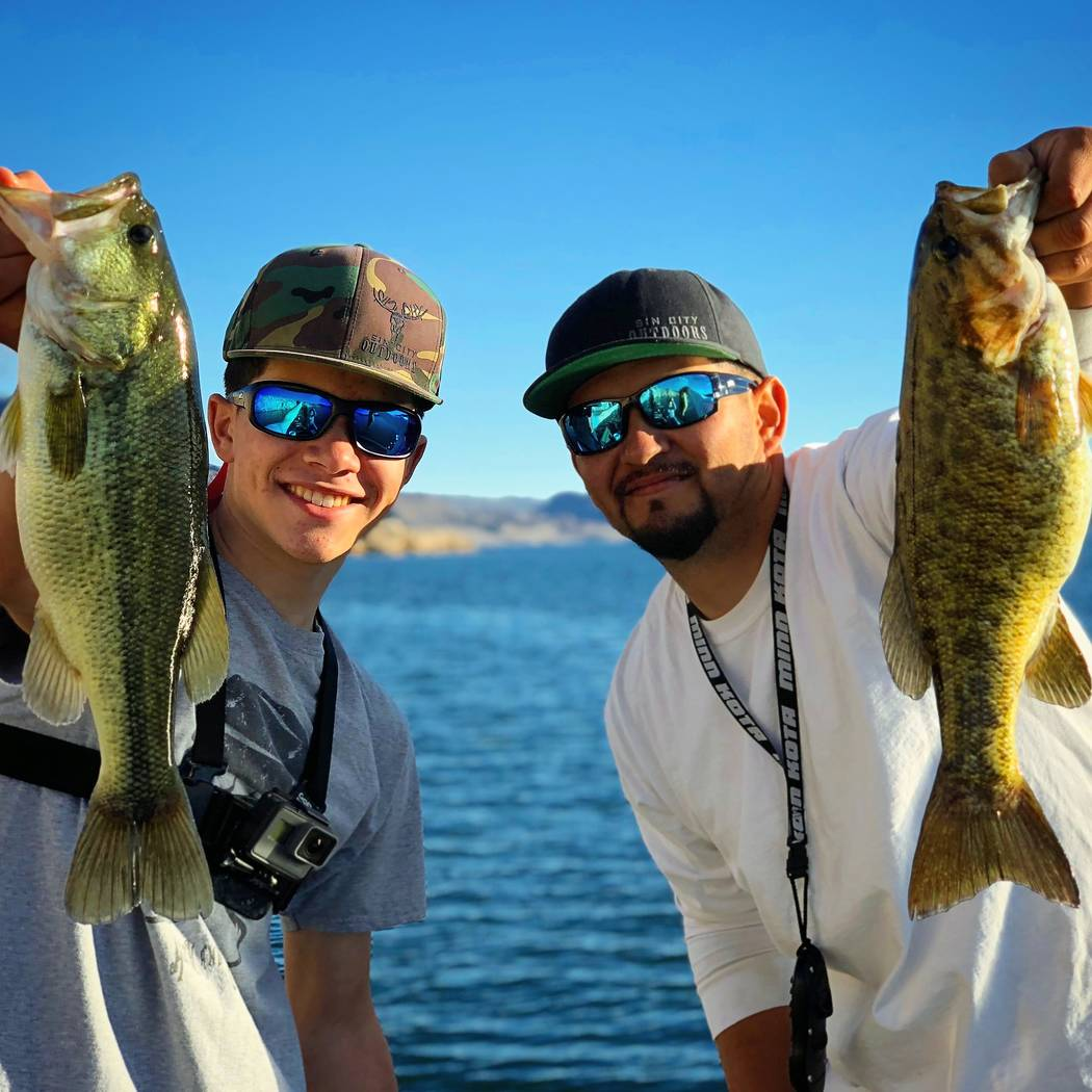 "Lake Mead is home to largemouth bass and smallmouth bass. Adrian Montero Jr., host of ""Sin City Outdoors,"" and his father show the results of a recent outing. (Adrian Montero)"