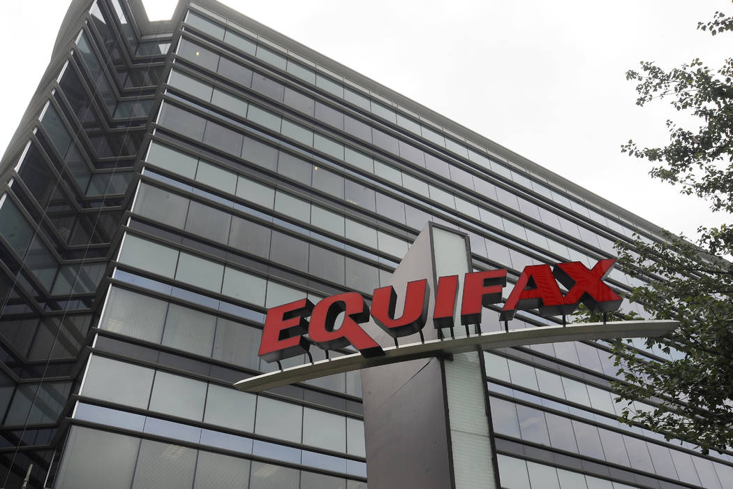 A former Equifax executive who sold stock for nearly $1 million before the company's massive data breach was publicly announced faces insider trading charges. (AP Photo/Mike Stewart, File)