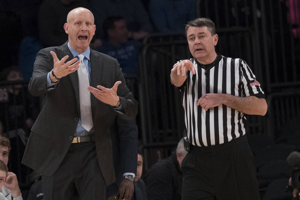 Xavier head coach Chris Mack argues with a referee during the first half of an NCAA college basketball game against St. John's in the quarterfinals of the Big East conference tournament, Thursday, ...