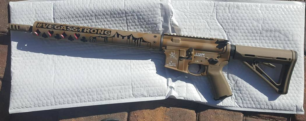 "A custom semiautomatic rifle with the Las Vegas Strip skyline and the words ""Vegas Strong"" engraved on the barrel was offered as a grand prize in the Las Vegas Metropolitan Police Department h ..."
