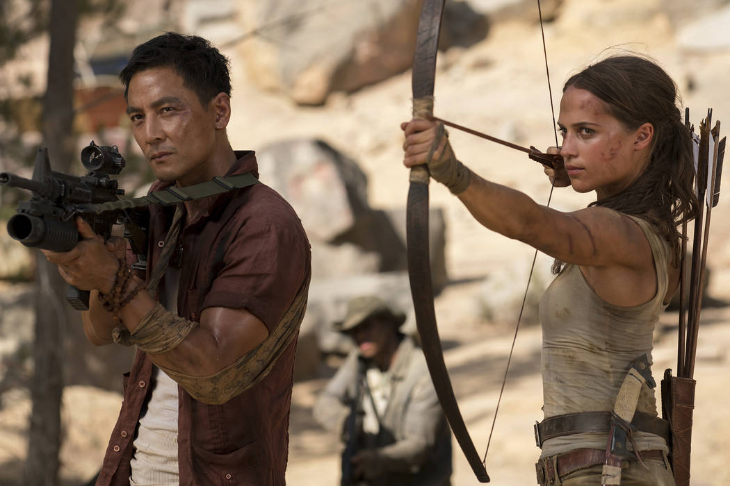 "This image released by Warner Bros. Pictures shows Daniel Wu, left, and Alicia Vikander in a scene from ""Tomb Raider."" (Ilze Kitshoff/Warner Bros. Pictures via AP)"