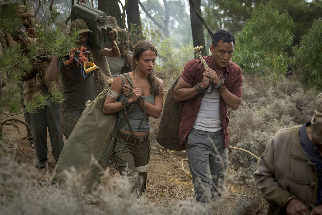 "This image released by Warner Bros. Pictures shows Alicia Vikander, left, and Daniel Wu in a scene from ""Tomb Raider."" (Graham Bartholomew/Warner Bros. Pictures via AP)"