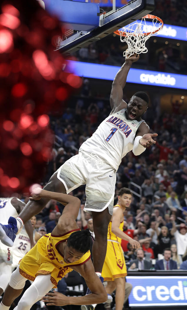 Arizona's Rawle Alkins dunks over Southern California's Elijah Stewart during the second half of an NCAA college basketball game for the Pac-12 men's tournament championship Saturday, March 10, 20 ...