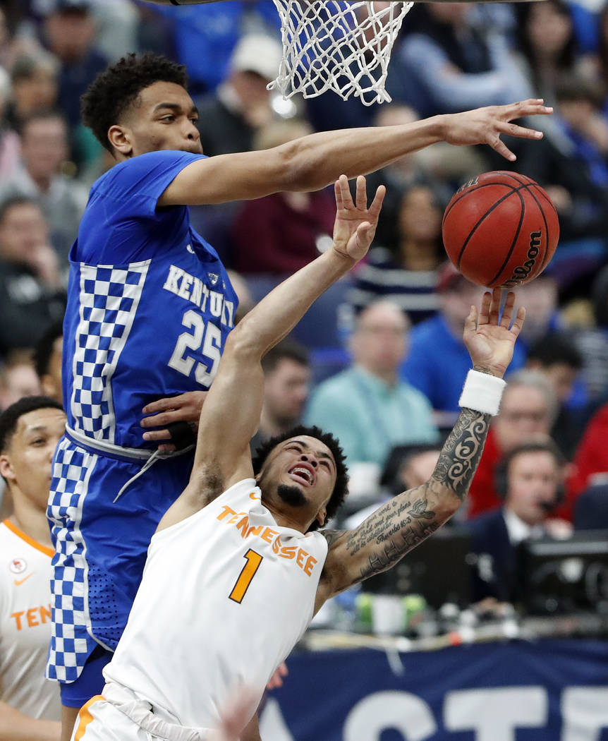 Kentucky's PJ Washington (25) blocks a shot by Tennessee's Lamonte Turner (1) during the second half of an NCAA college basketball championship game at the Southeastern Conference tournament Sunda ...