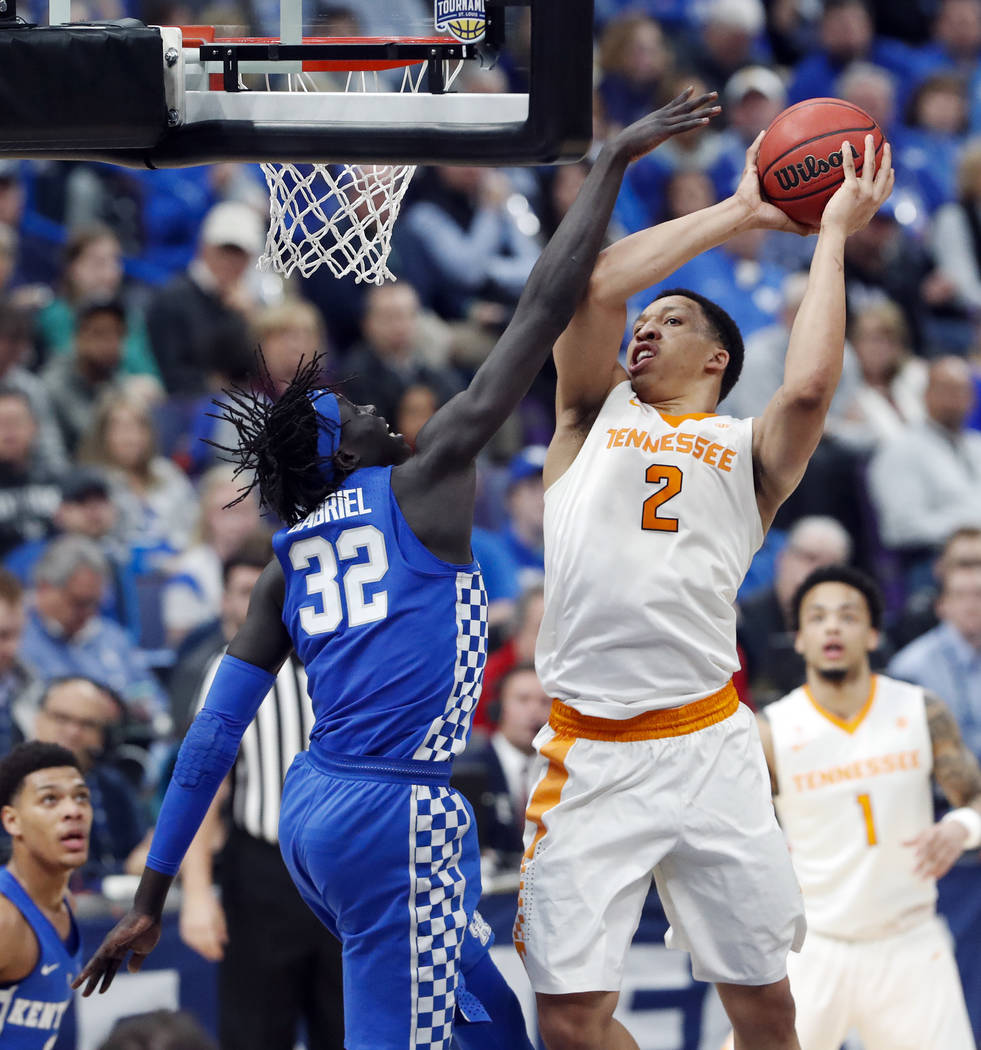 Tennessee forward Grant Williams (2) is defended by Kentucky's Wenyen Gabriel (32) during the second half of an NCAA college basketball championship game at the Southeastern Conference tournament  ...
