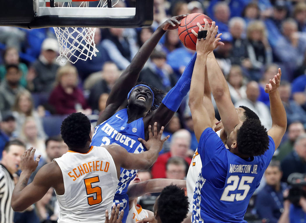 Kentucky's Wenyen Gabriel, second from left, grabs a rebound during the second half of an NCAA college basketball championship game against Tennessee at the Southeastern Conference tournament Sund ...