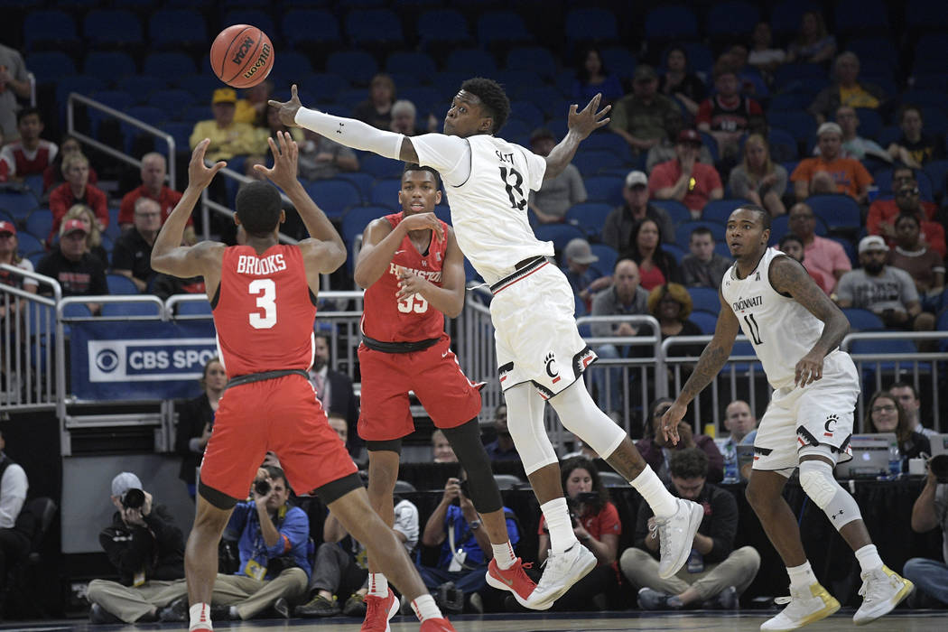 Cincinnati forward Tre Scott (13) deflects a pass from Houston forward Fabian White Jr. (35) to guard Armoni Brooks (3) during the second half of an NCAA college basketball championship game at th ...
