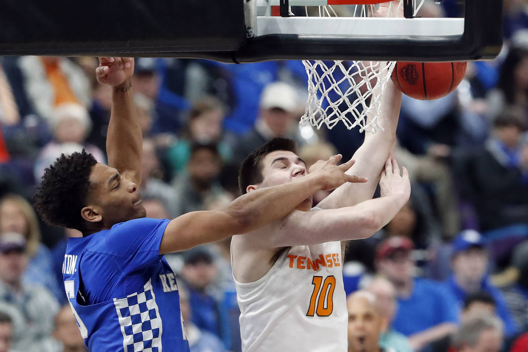 Tennessee's John Fulkerson (10) shoots as he is defended by Kentucky's PJ Washington, left, during the second half of an NCAA college basketball championship game at the Southeastern Conference to ...