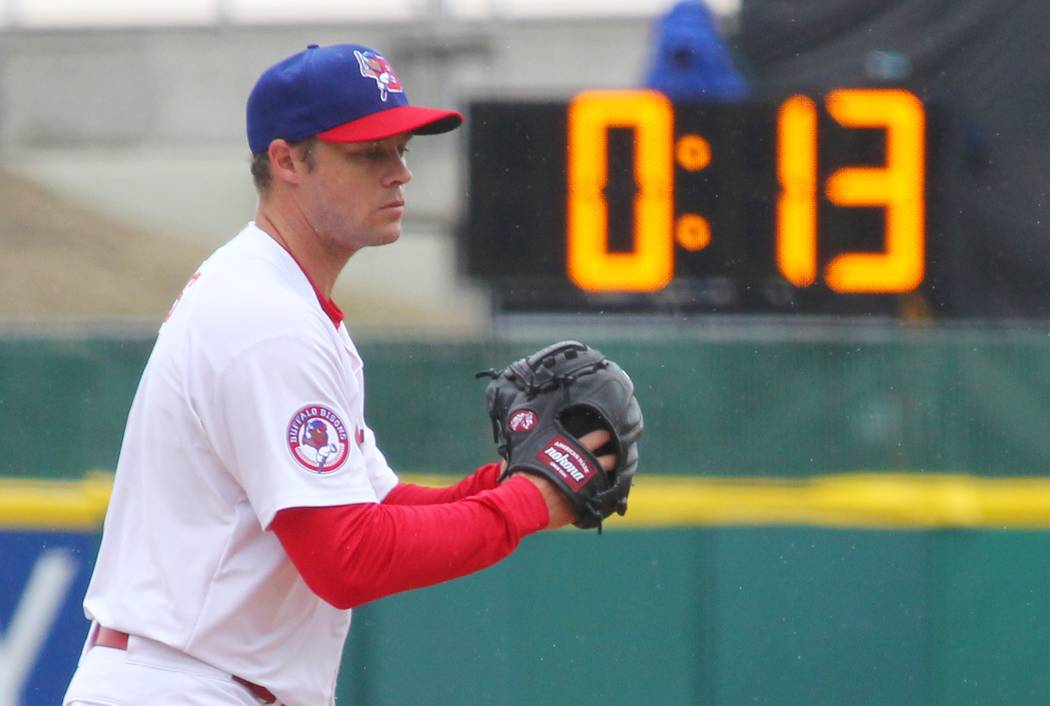 Buffalo Bisons pitcher Andrew Albers (14) delivers a pitch as a 20-second pitch clock is used for the Triple-A baseball opener between the Buffalo Bisons and Rochester Red Wings in Buffalo, N.Y.,  ...