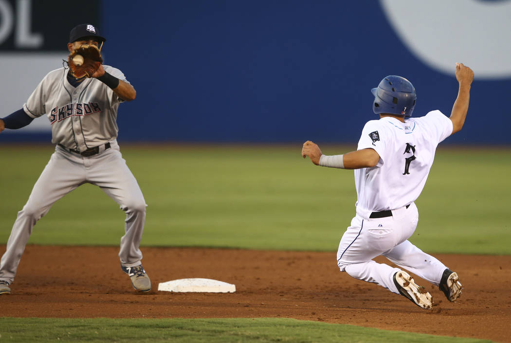 "Colorado Springs Sky Sox' Yadiel Rivera tags out Las Vegas 51s' Josh Rodriguez (7) during the debut of the ""Reyes de Plata"" (Silver Kings), part of a new Minor League Baseball initiative, at Cashm ..."