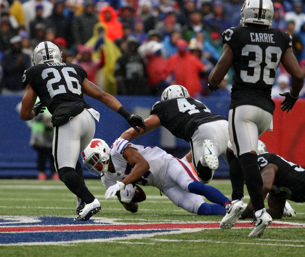 Oakland Raiders defensive end James Cowser (47) leaps in to finish a tackle with middle linebacker NaVorro Bowman (53) on Buffalo Bills wide receiver Jordan Matthews (87) during the first half of  ...