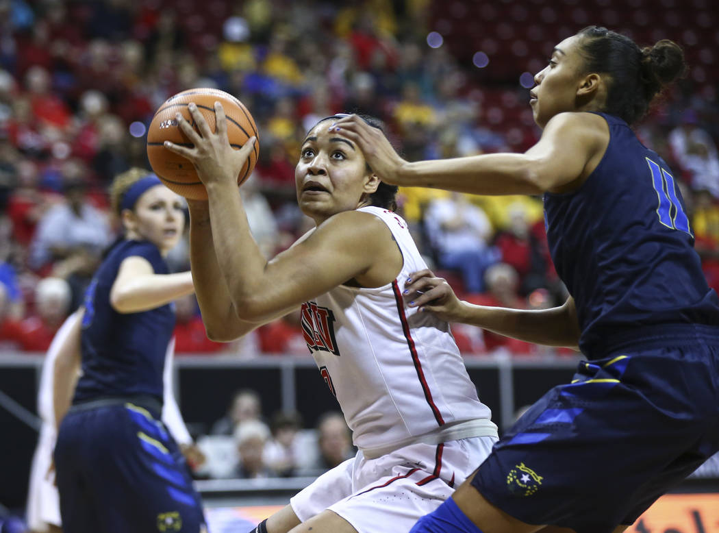 UNLV Lady Rebels forward/center Paris Strawther (3) looks to shoot in front of UNR Wolf Pack forward Terae Briggs (11) during the first half of a basketball game in the Mountain West tournament qu ...