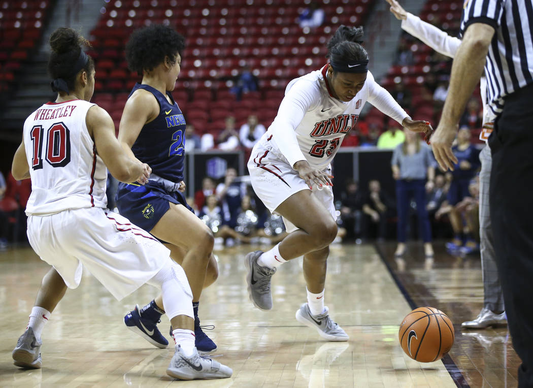 UNLV Lady Rebels forward Jordyn Bell (23) tries to save a loose ball during the second half of a basketball game against the UNR Wolf Pack in the Mountain West tournament quarterfinals at the Thom ...