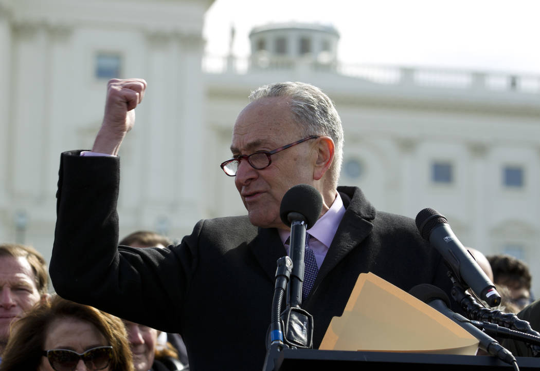 Senate Minority Leader Chuck Schumer, D-N.Y., speaks during a students rally asking for gun control outside of the U.S. Capitol building, Wednesday, March 14, 2018, in Washington. One month after  ...