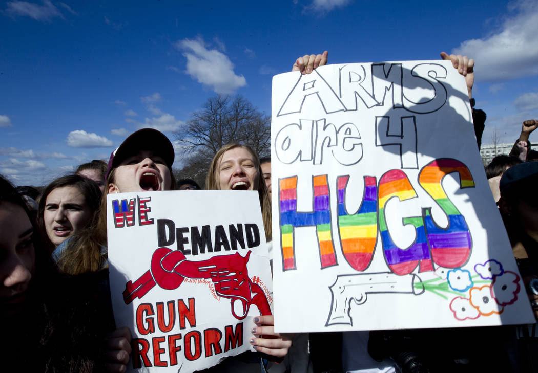Students hold up their signs during a rally asking for gun control outside of the U.S. Capitol building, Wednesday, March 14, 2018, in Washington. One month after a mass shooting in Florida, stude ...