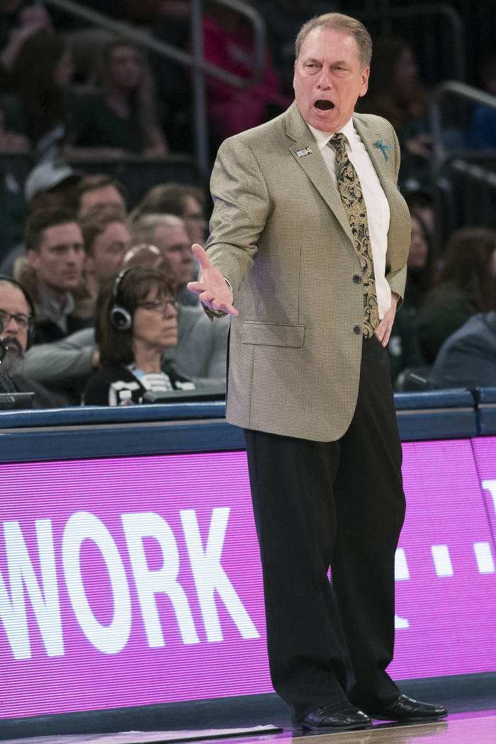 Michigan State head coach Tom Izzo reacts during the first half of an NCAA college basketball game against Wisconsin in the quarterfinals of the Big Ten conference tournament, Friday, March 2, 201 ...
