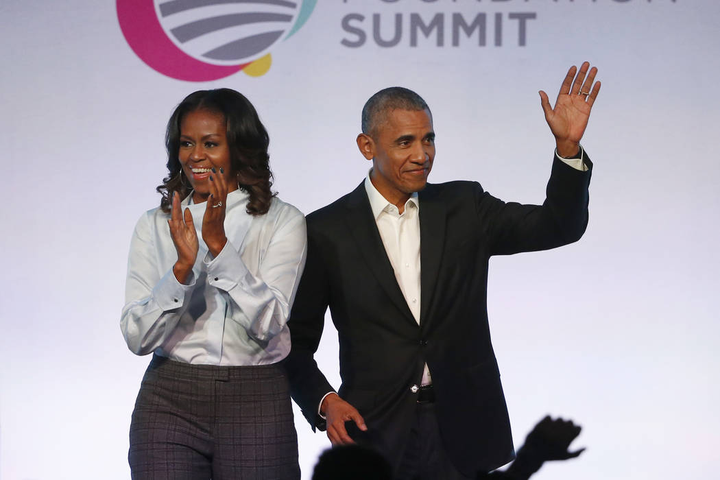 In this Oct. 13, 2017 file photo, former President Barack Obama, right, and former first lady Michelle Obama arrive for the first session of the Obama Foundation Summit in Chicago. (AP Photo/Charl ...