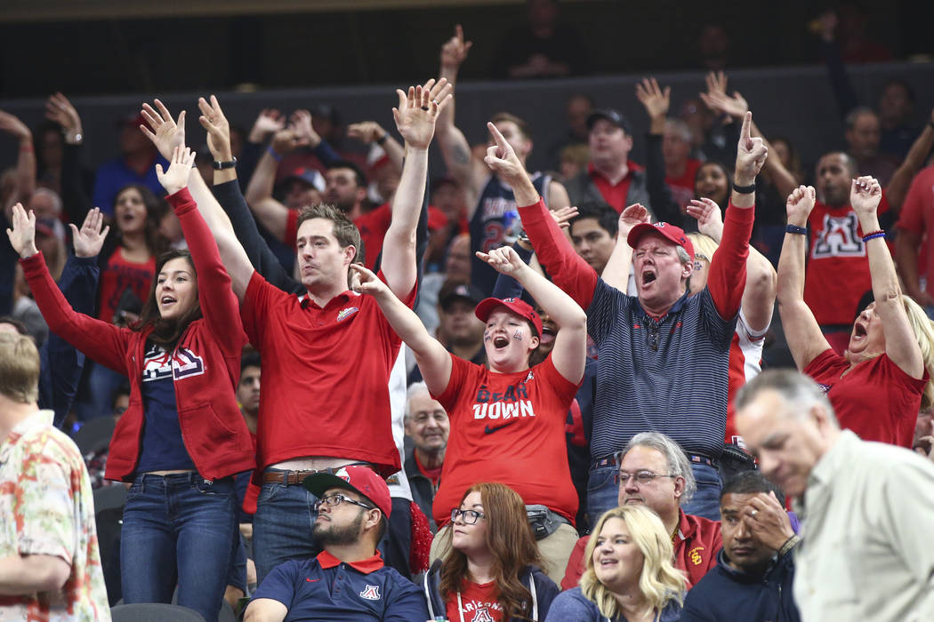 Arizona Wildcats fans cheer before their team takes on the USC Trojans in the Pac-12 tournament championship basketball game at T-Mobile Arena in Las Vegas on Saturday, March 10, 2018. Chase Steve ...