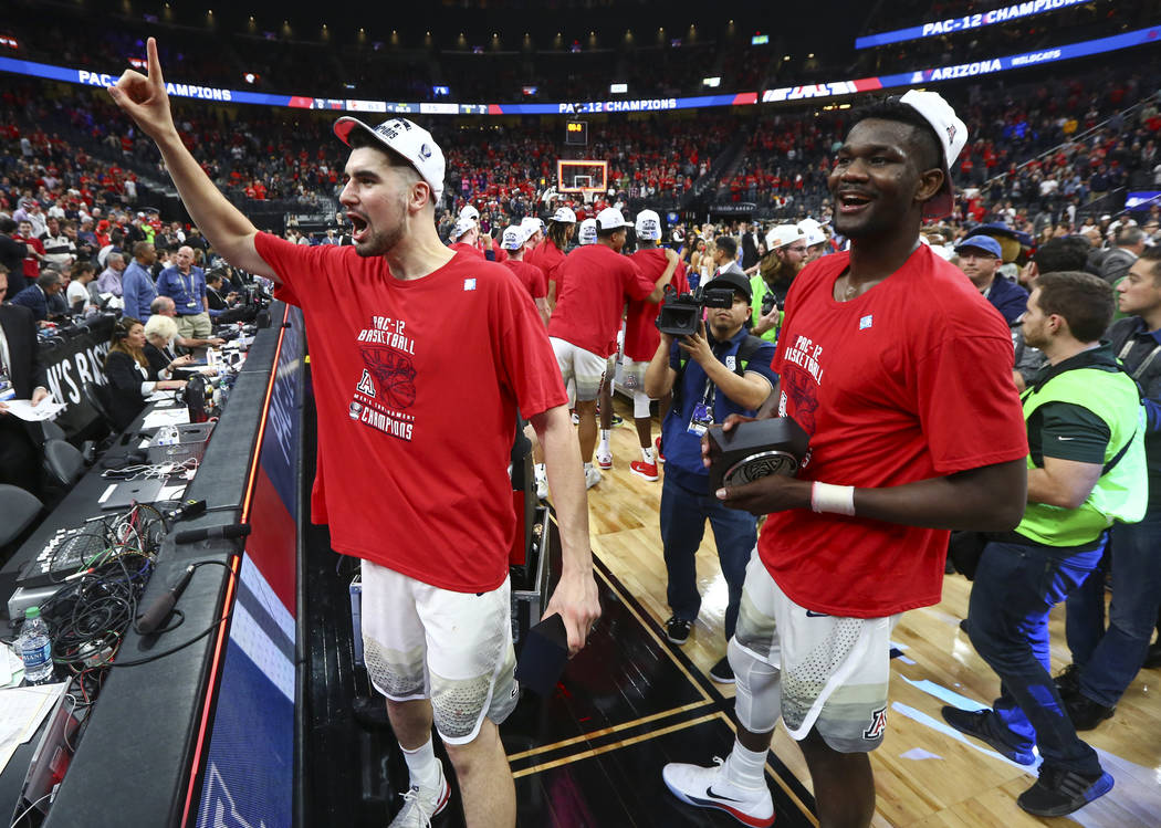 Arizona Wildcats forward Deandre Ayton, right, and center Dusan Ristic celebrate after defeating the USC Trojans in the Pac-12 tournament championship basketball game at T-Mobile Arena in Las Vega ...