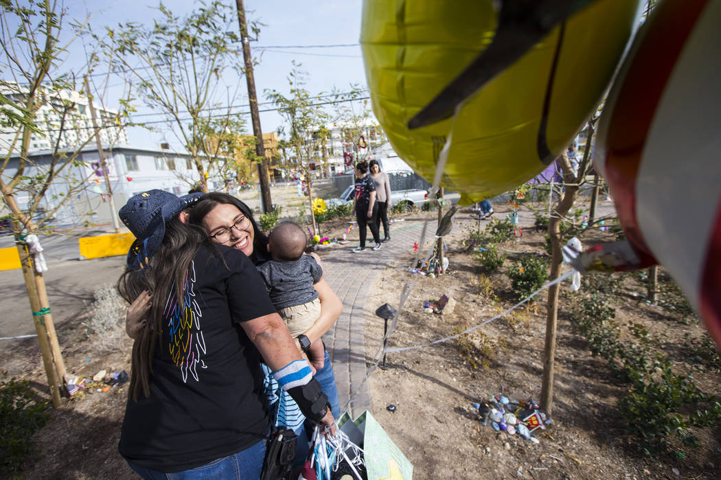Oct. 1 shooting survivor Sue Ann Cornwell, left, greets Miriam Lujan, who she helped rescue, and Lujan's son, Xander Finch, who was born in the weeks following the shooting, while visiting the Com ...