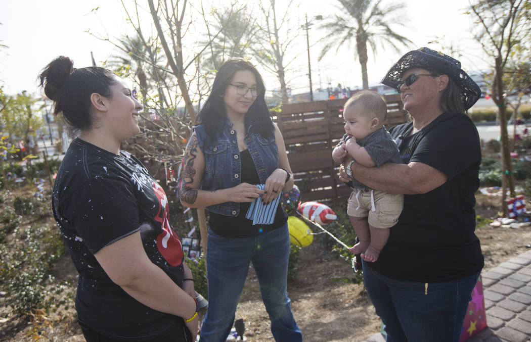 Oct. 1 shooting survivors, from left, Cynthia Velez, Miriam Lujan, and Sue Ann Cornwell, with infant Xander Finch whose mother Miriam Lujan, left, was rescued by Cornwell at the Route 91 festival, ...
