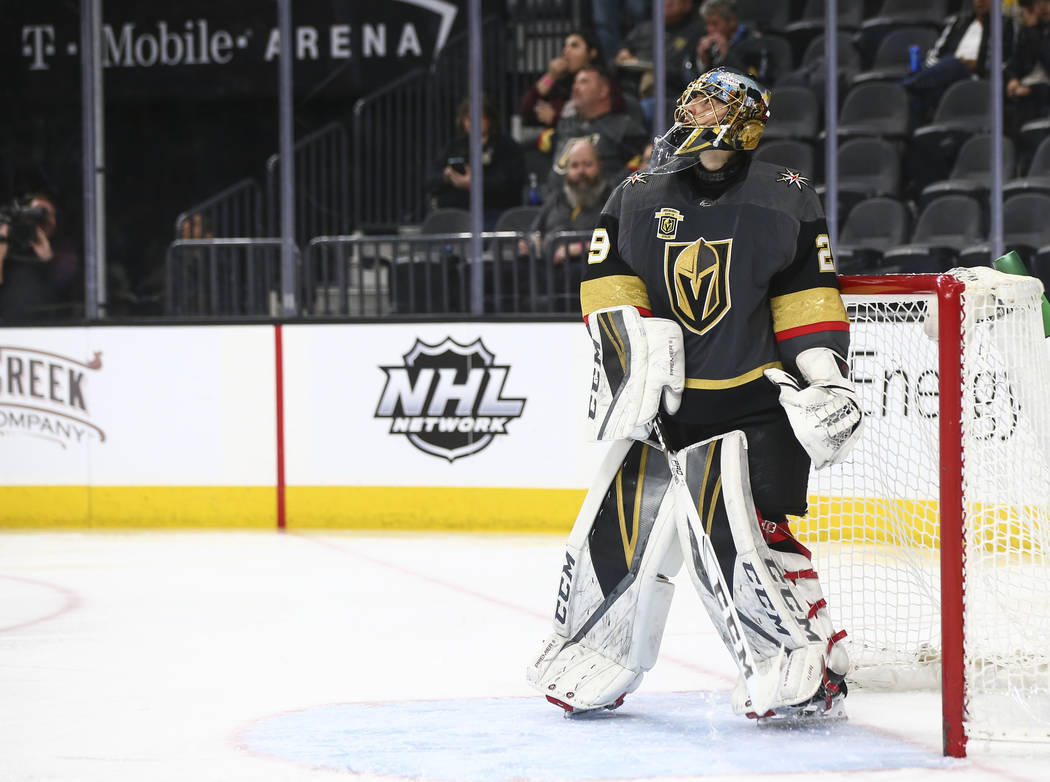 Golden Knights goaltender Marc-Andre Fleury (29) checks the scoreboard after getting scored on for the third time by the New Jersey Devils during the second period of an NHL hockey game at T-Mobil ...