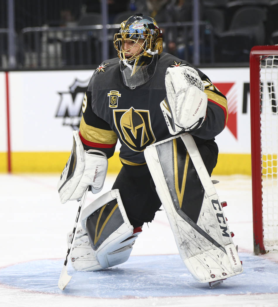 Golden Knights goaltender Marc-Andre Fleury (29) defends the goal while playing the New Jersey Devils during the second period of an NHL hockey game at T-Mobile Arena in Las Vegas on Wednesday, Ma ...