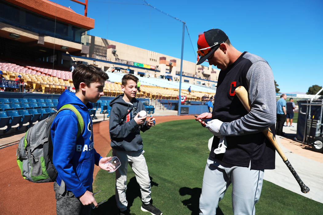 Cleveland Indians' Bradley Zimmer signs autographs for Ryan Shulman, 13, left, and Jackson Tanko, 13, before the annual Big League Weekend baseball game at Cashman Field in Las Vegas on Sunday, Ma ...