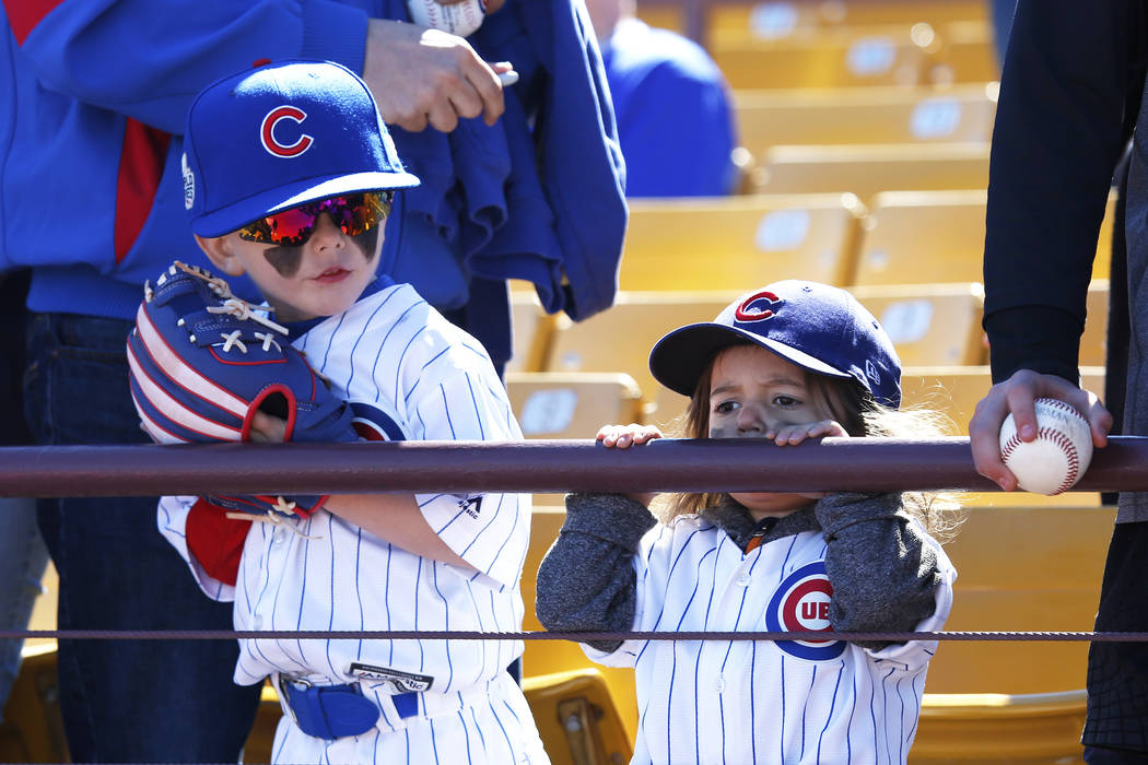 Otto Braverman, 5, and his 2-year-old sister, Otto, attend the annual Big League Weekend baseball game at Cashman Field in Las Vegas on Sunday, March 18, 2018. Andrea Cornejo Las Vegas Review-Jour ...