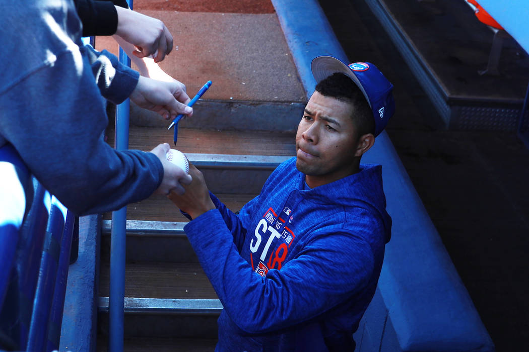 Chicago Cubs' Jose Quintana signs autographs before the annual Big League Weekend baseball game at Cashman Field in Las Vegas on Sunday, March 18, 2018. Andrea Cornejo Las Vegas Review-Journal @Dr ...