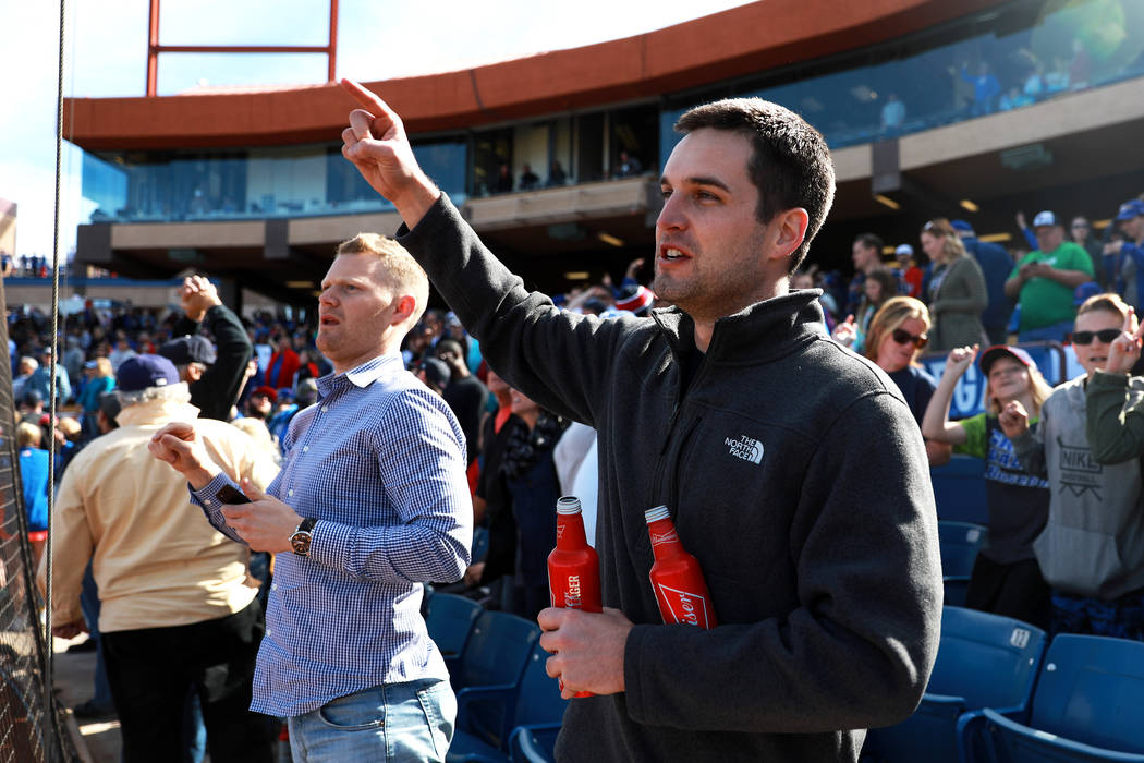 Mike O'Hara, 28, right, and Matthew Anderson, 28, sing along during the annual Big League Weekend baseball game at Cashman Field in Las Vegas on Sunday, March 18, 2018. Andrea Cornejo Las Vegas Re ...