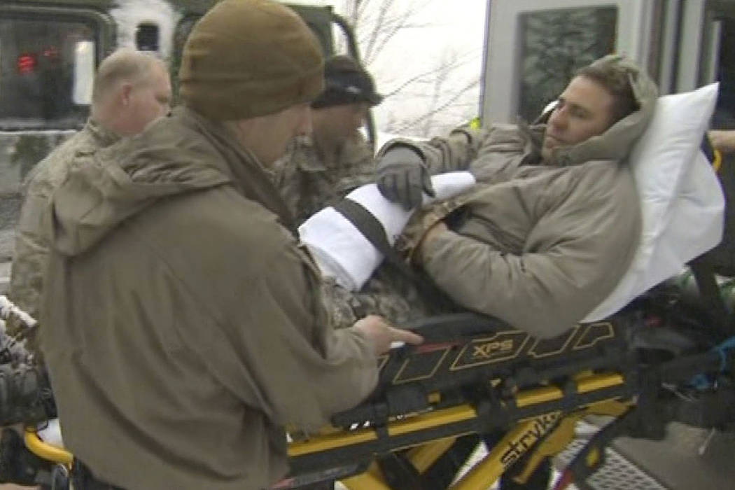 In this still image from video provided by WCAX-TV Channel 3, a U.S. Army soldier is evacuated on a stretcher, right, following an avalanche Wednesday, March 14, 2018, after participating in U.S.  ...