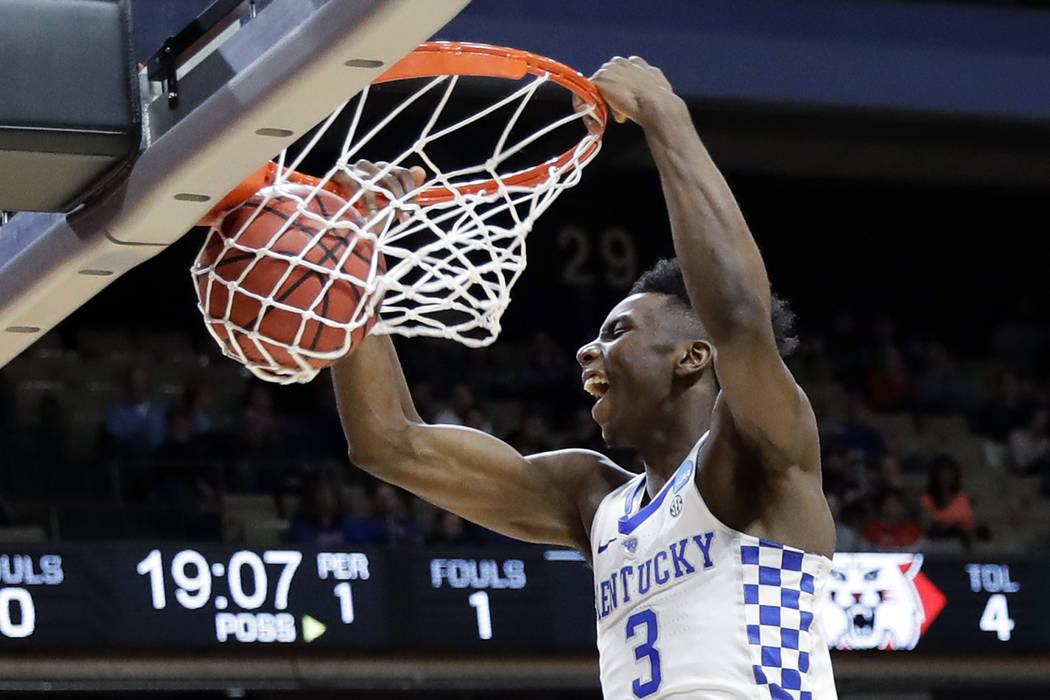 Kentucky guard Hamidou Diallo starts off the team's first-round game against Davidson with a dunk during the NCAA men's college basketball tournament Thursday, March 15, 2018, in Boise, Idaho. (AP ...