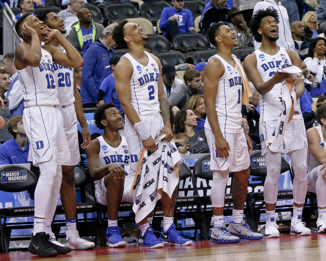 Duke's Javin DeLaurier (12), Marques Bolden (20), Gary Trent Jr. (2), Trevon Duval (1) an Marvin Bagley III, right, cheer as they watch a replay of a dunk by teammate Justin Robinson during the se ...