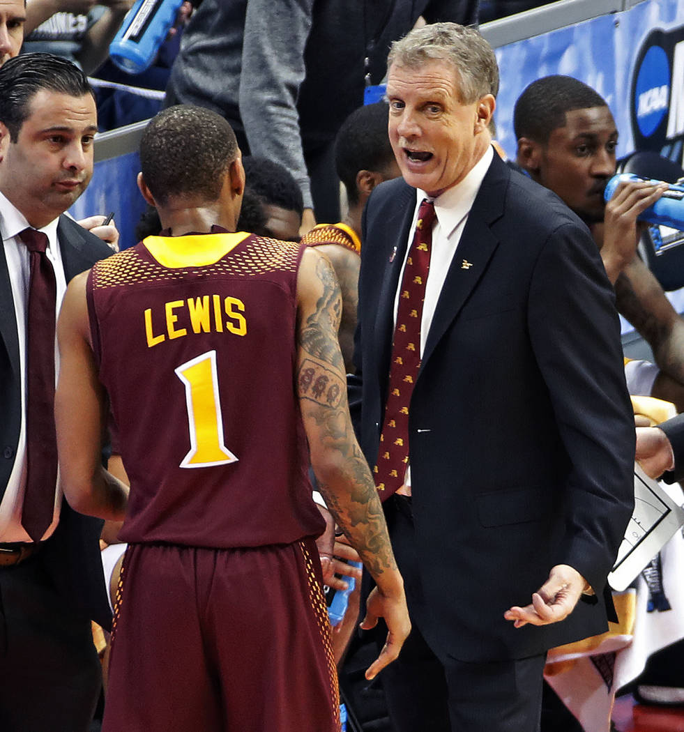 Iona head coach Tim Cluess, right, talks with Zach Lewis (1) as he heads to the bench late in the second half of an NCAA men's college basketball tournament first-round game against Duke, in Pitts ...