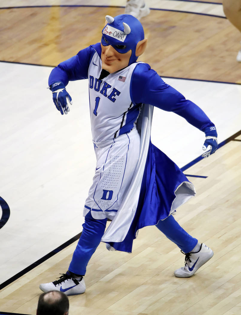 The Duke Blue Devil mascot struts on the court during a timeout in the second half of an NCAA men's college basketball tournament first-round game between Iona and Duke, in Pittsburgh, Thursday, M ...