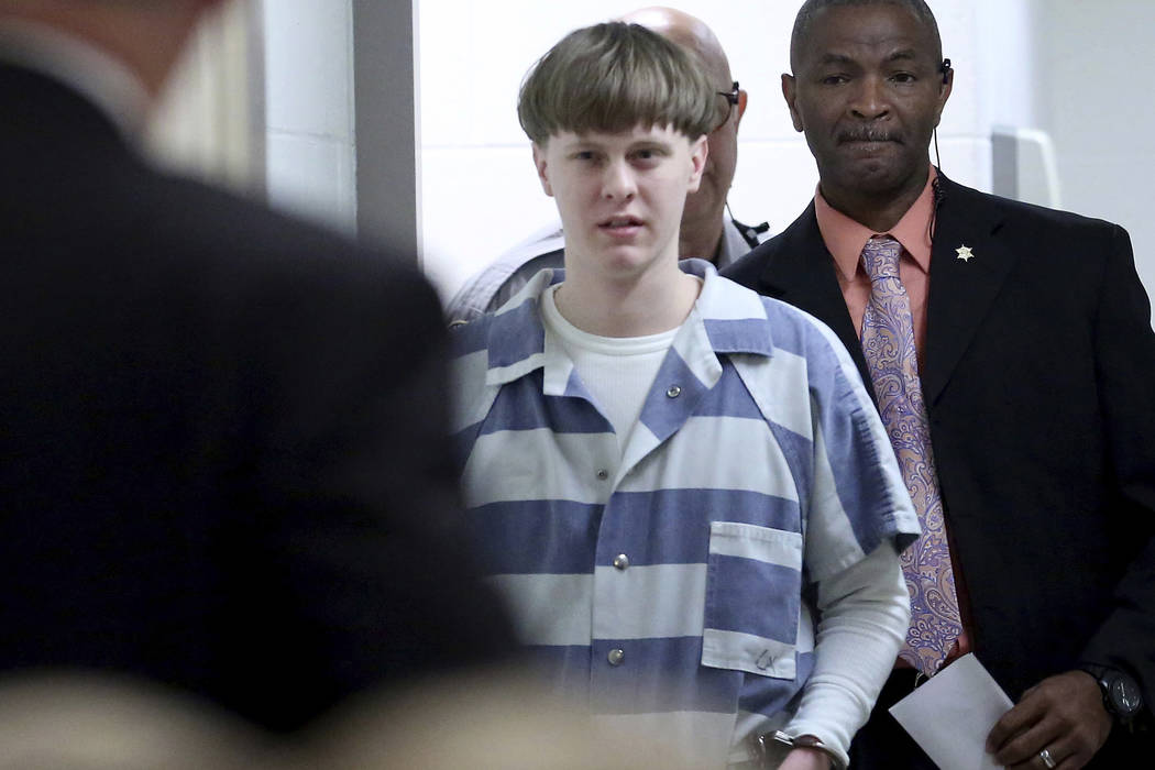 Dylann Roof enters the courtroom at the Charleston County Judicial Center to enter his guilty plea on murder charges April 10, 2017, in Charleston, South Carolina. Roof, a white supremacist who wa ...