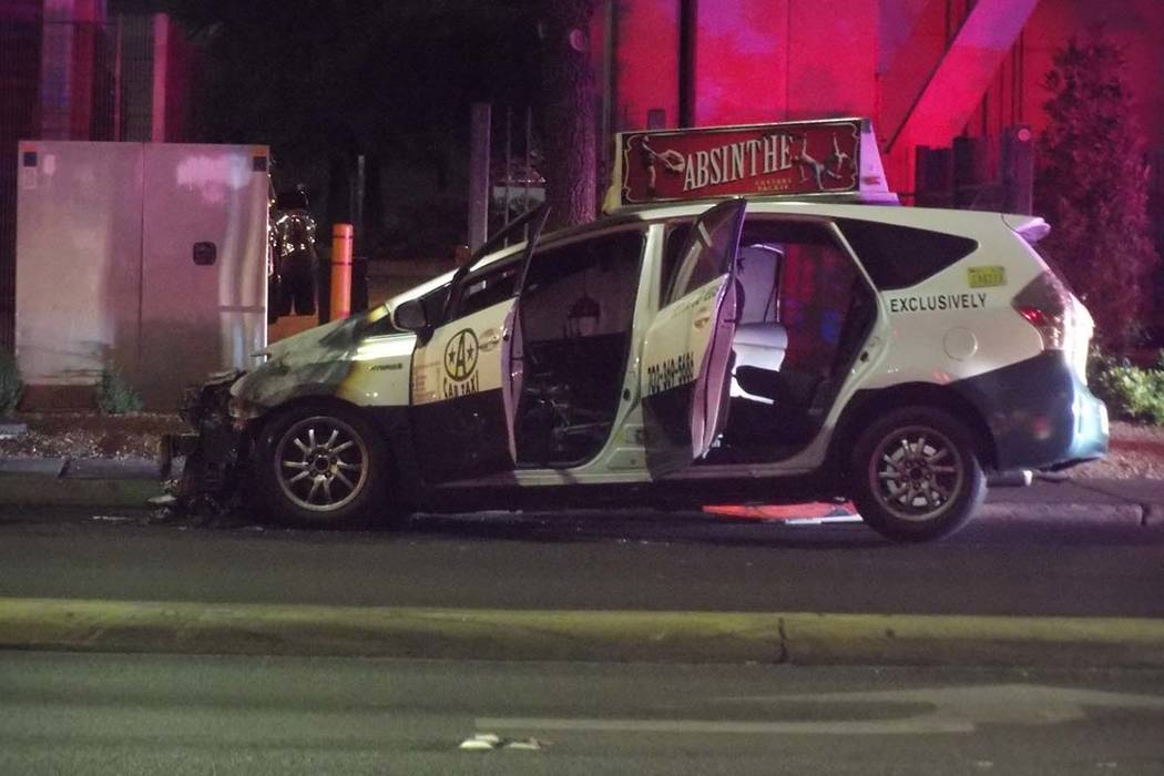 A taxi caught fire early Thursday on Paradise Road near Desert Inn. Nobody was injured and police did not know the cause of the fire. (Max Michor/Las Vegas Review-Journal)