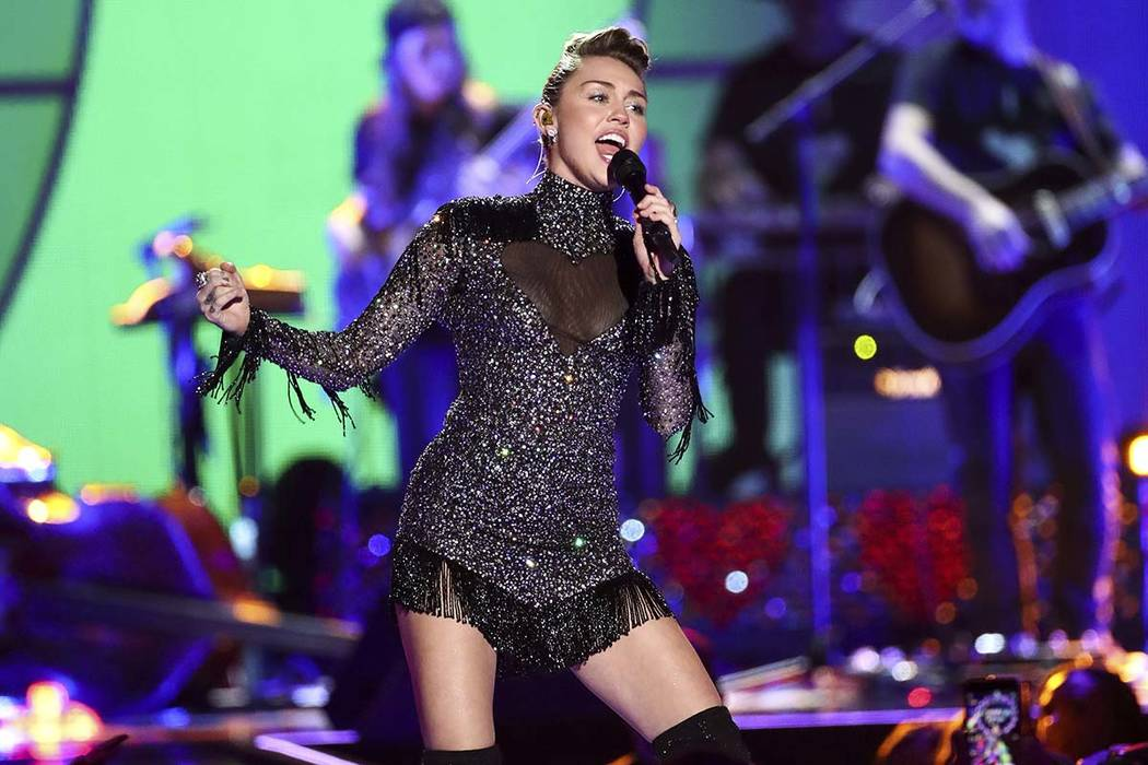 Miley Cyrus performs at the 2017 iHeartRadio Music Festival Day 2 held at T-Mobile Arena on Saturday, Sept. 23, 2017, in Las Vegas. (John Salangsang/Invision/AP)