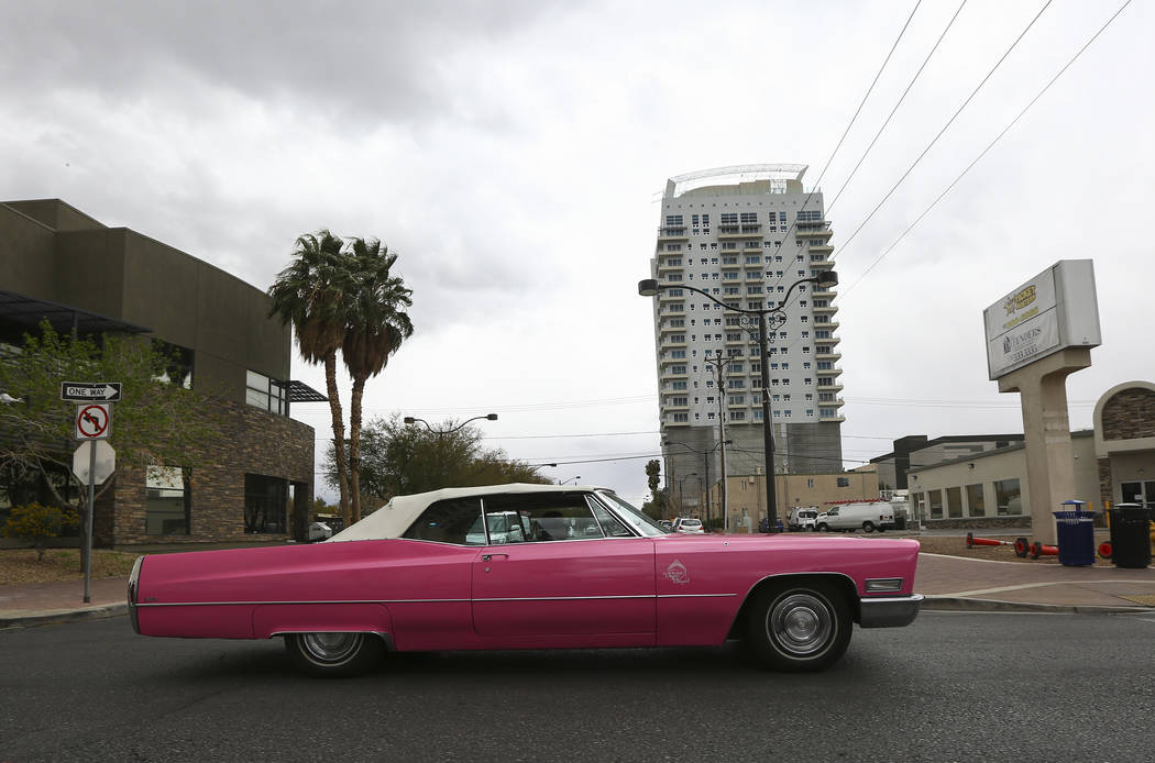 A pink Cadillac from The Little Vegas Chapel drives down 4th Street as clouds cover the sky over downtown Las Vegas on Thursday, March 15, 2018. Chase Stevens Las Vegas Review-Journal @csstevensphoto